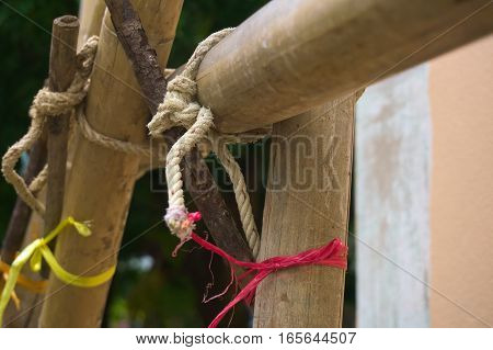 The scaffolding of bamboo lashed together with rope on the wrench.