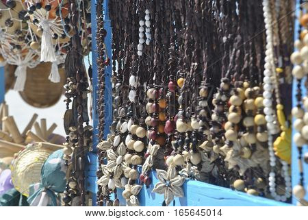 Detail of handcraft necklaces made with coconut