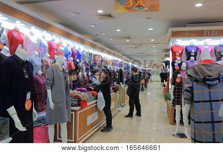 SHANGHAI CHINA - OCTOBER 30, 2016: Unidentified people visit Shanghai Fashion Store on Nanjing Road.