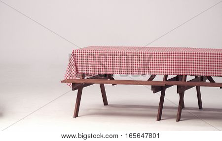 Wood table and red napkin for outdoor party and white background.