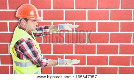 Young Builder With Something Big Between Hands