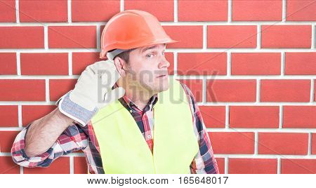 Curious Male Builder Listening The News