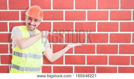 Male Builder Indicate Towards His Empty Hand