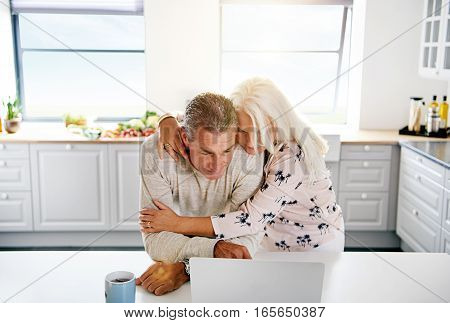 Two Elderly People Browsing The Internet