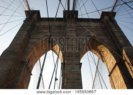 Brooklyn Bridge Details, Medieval archs and metal ropes from brooklyn bridge