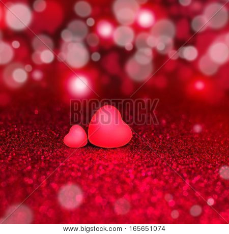 Two Red Hearts On Red Sparkle Glitter Background