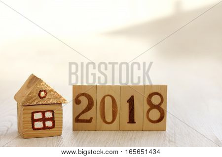 idea of a wooden house with numbers indicating the year / personal property by 2018