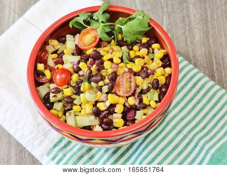Simple, delicious and fresh, this black bean and corn salad by itself or added to tacos, green salad or wraps.
