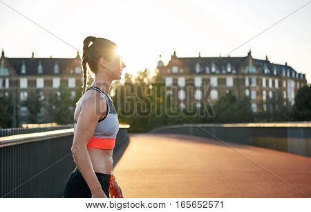 Female Runner Practicing On Empty Road