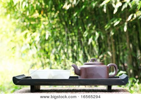 Classical asian tea set at outdoors poster