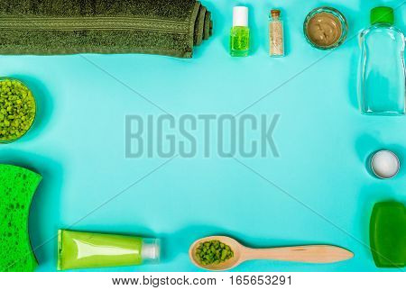 Spa set: soap, mask, oil, sea salt and towel. Top view. Still life Copy space