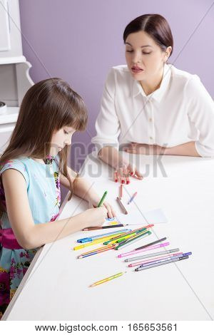 Happy Mother Teach Her Daughter To Paint.