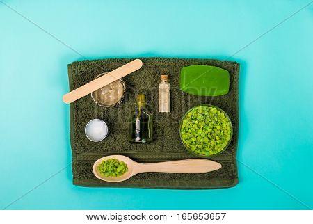 Spa set: soap, mask oil, sea salt and towel. Top view. Still life