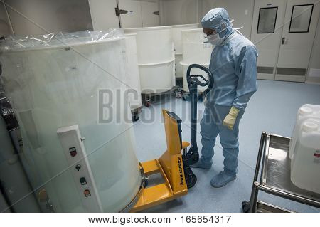 ST. PETERSBURG, RUSSIA - NOVEMBER 16, 2016: Staff working in clean area in the production site of the biotechnology company BIOCAD.  Full-cycle drug development and manufacturing companies