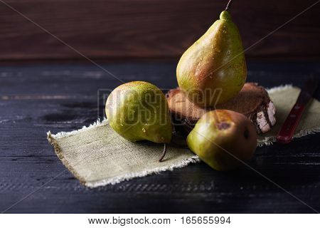 Fresh green pears on a rustic background on a napkin.