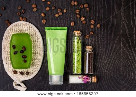 soaps, bath salt, mask on wood table background. spa. top view. still life