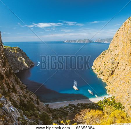 Summer butterfly valley sea beach view and cruise boat Oludeniz, Turkey