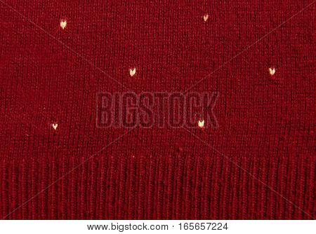white hearts on knitted red wool background