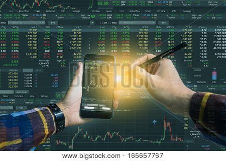 Double exposure of Hand holding smart phone checking financial stats on screen for trading stock concept.