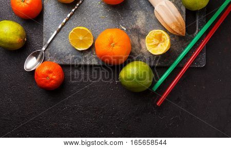 Fresh Ripe Citruses On A Stone Background.
