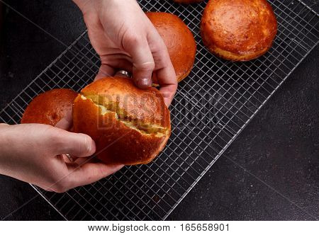 Tasty Fresh Newly-baked Buns On A Iron Grid Over Stone Background