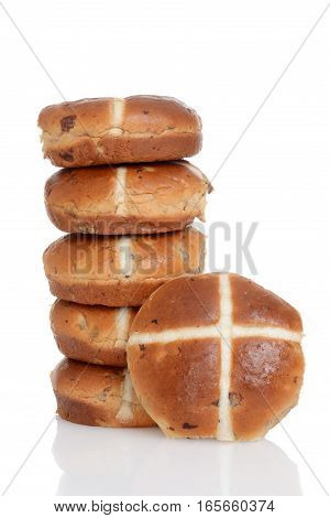 pile of hot cross buns with white background