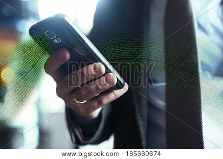 Businessman in suit jacketshirt tie using his smart phone