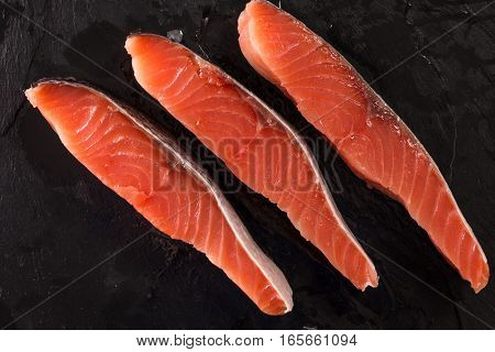 Fillet Of Salmon On Dark Wooden Background, Healthy Food
