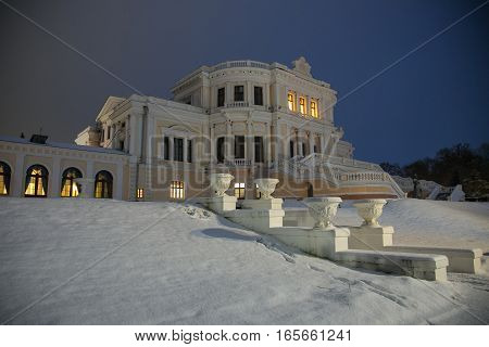 Central part of an ancient noble mansion in winter night. Estate Maryino, Kursk region