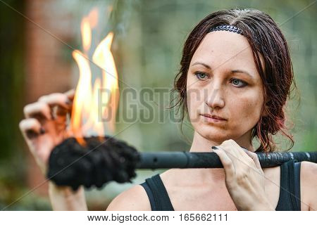 girl with flaming torches Fire show