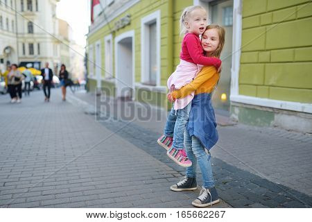 Two Cute Little Sisters Sightseeing In Vilnius, Lithuania