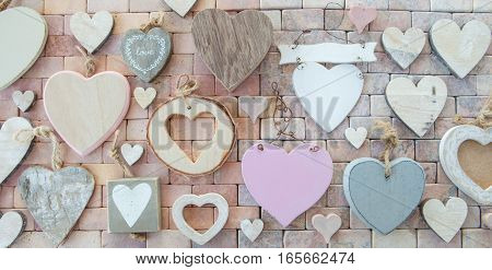 Variety of wooden hearts on a marbled stone background