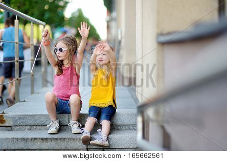 Two Cute Little Sisters Having A Walk Together