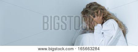 Terrified Depressed Woman In Empty Room