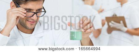 Scientist Holding Beaker With Liquid