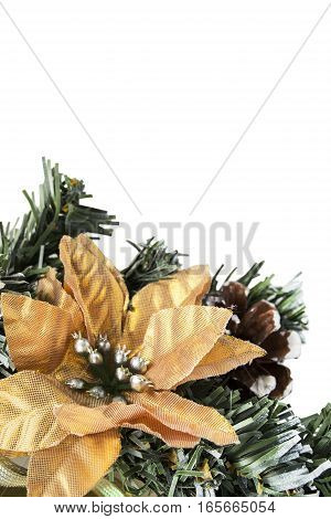 Yellow flower on synthetic christmas tree branch closeup