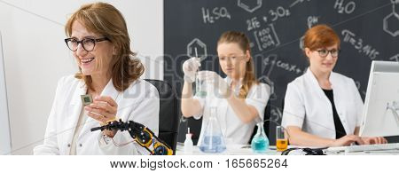 Smiling Chemistry Teacher With Students