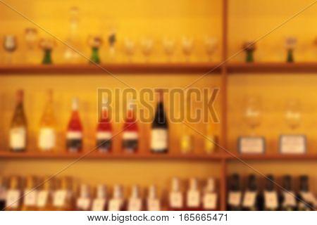 blured bottle of wine on the shelves