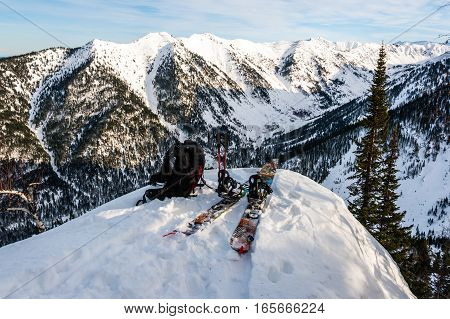 Splitboard backpack and ski poles on the mountain background