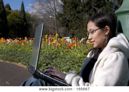 Asian Teenager With Laptop