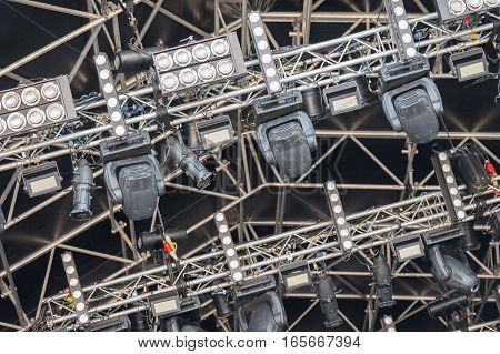 multiple spotlights on a festival stage lighting rig - equipment identifications removed
