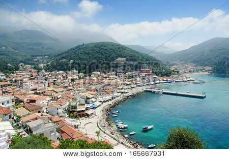 Blue sea mountains and mediterranean houses on sunny day - Parga Greece