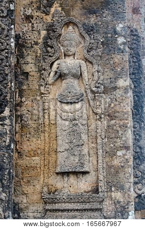 Carving of an Apsara or Cambodian celestial nymph on the walls of Pre Rup Temple in Angkor