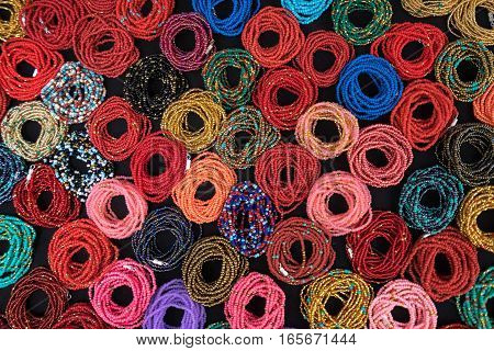 pattern created by colourful bracelets in otavalo Ecuador