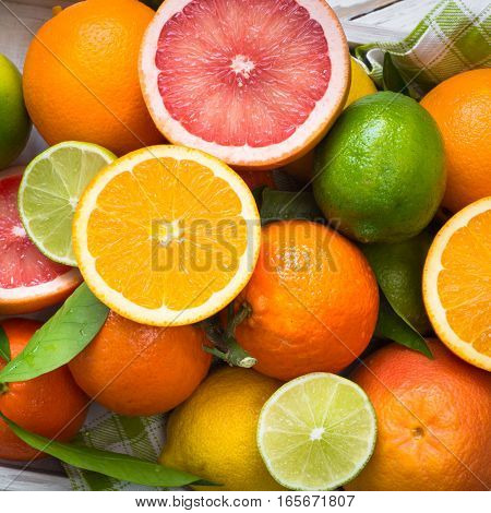 Different citrus fruit. Whole and sliced fruits. Fruit food background. Healthy eating and diet.