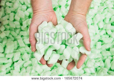 Hands Holding Polystyrene Loosefill