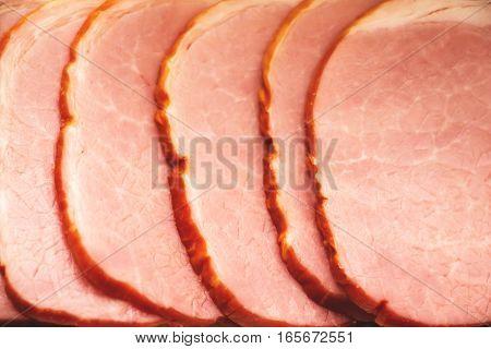 Tasty slices of ham close up 2