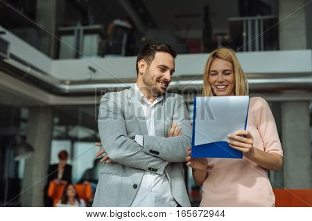 Woman working with her colleague in the office.