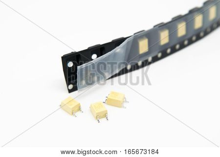 Electronics SMD components in a black plastic carrier tape.