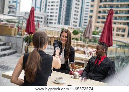 Multiracial contemporary business people working outdoor in town.